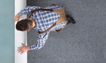 Man rolling Carpet | All Floors Design Centre