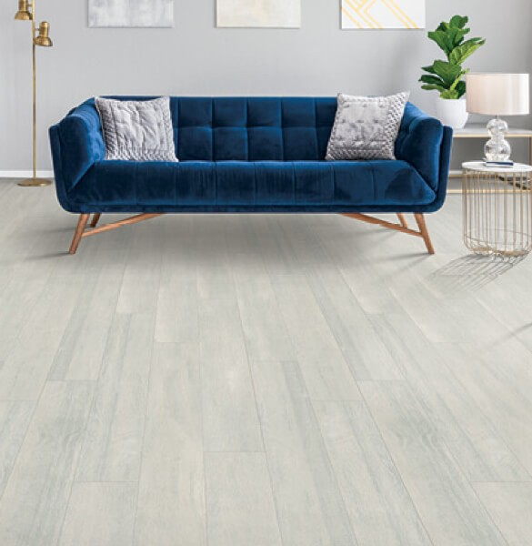 Blue couch on Laminate flooring | All Floors Design Centre