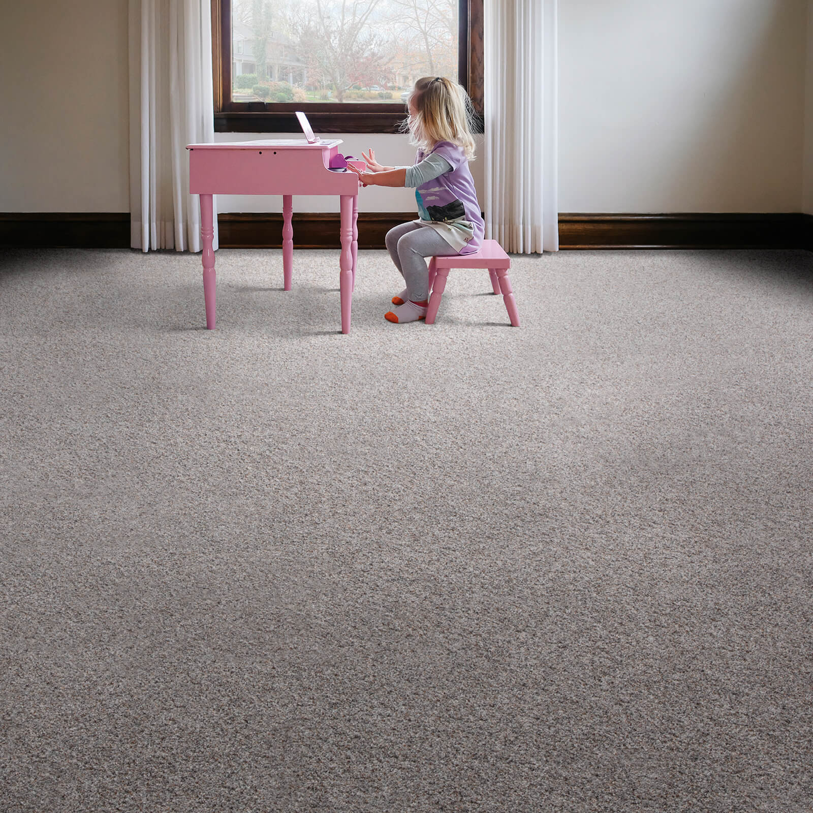 Girl with piano on Carpet flooring | All Floors Design Centre