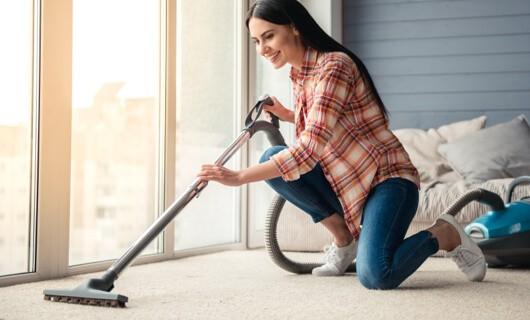 Vacuuming carpet | All Floors Design Centre