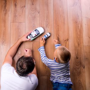 Father with kid playing with toycar | All Floors Design Centre