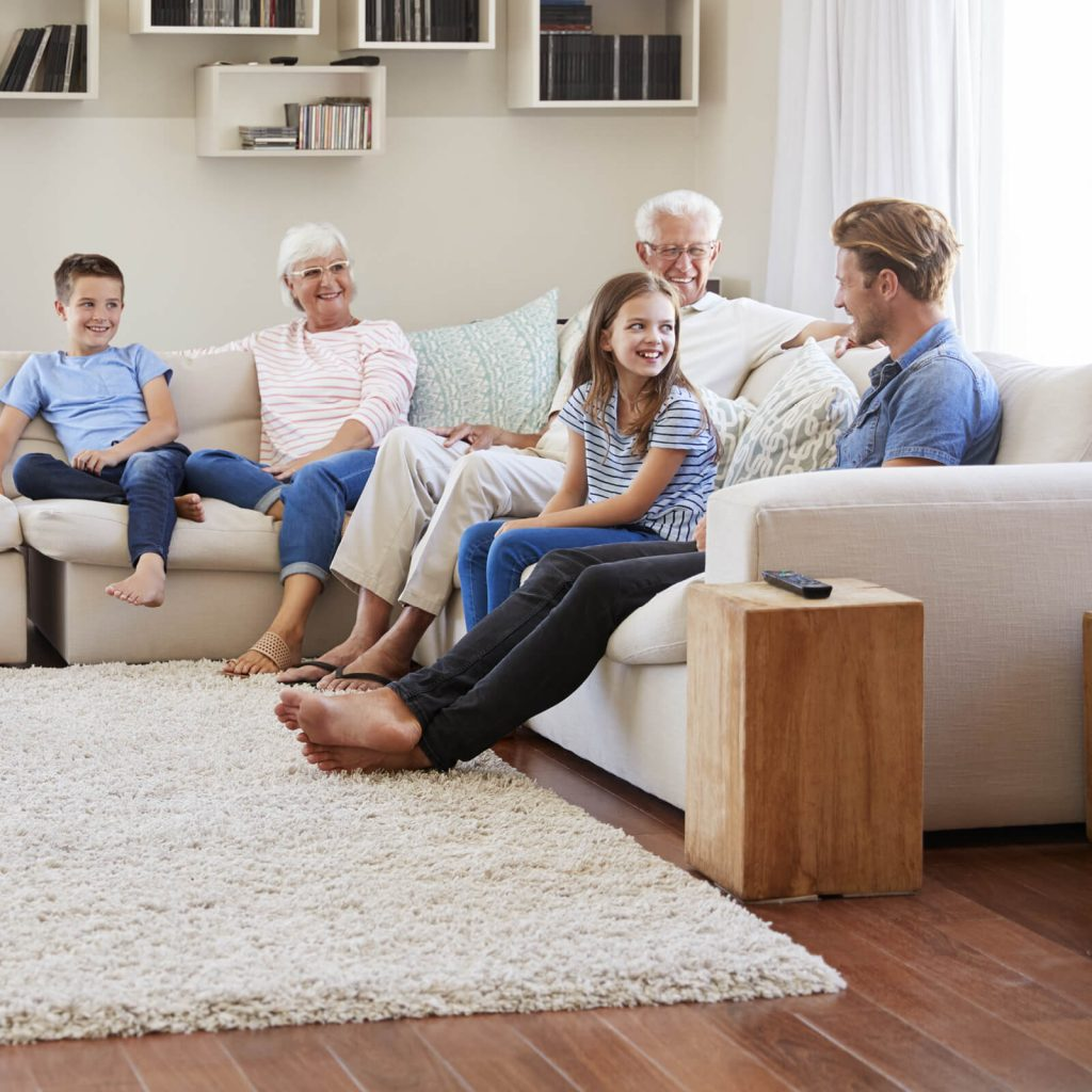 Family get together in living room | All Floors Design Centre