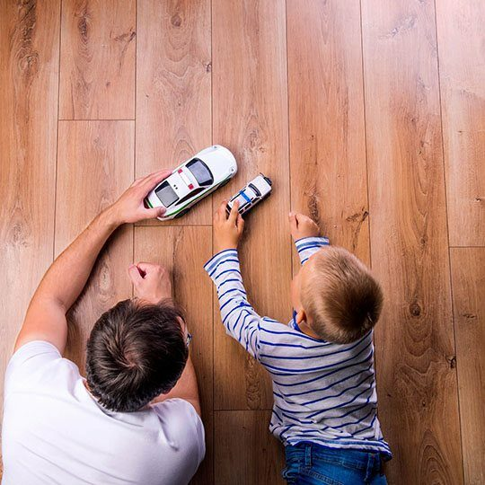 Father and kid playing with toycar | All Floors Design Centre